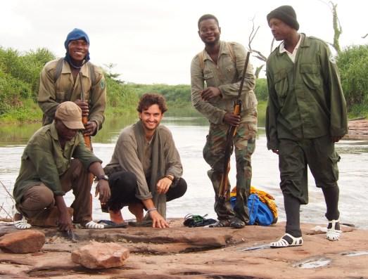 With rangers, after trekking through Digya national park, Ghana.