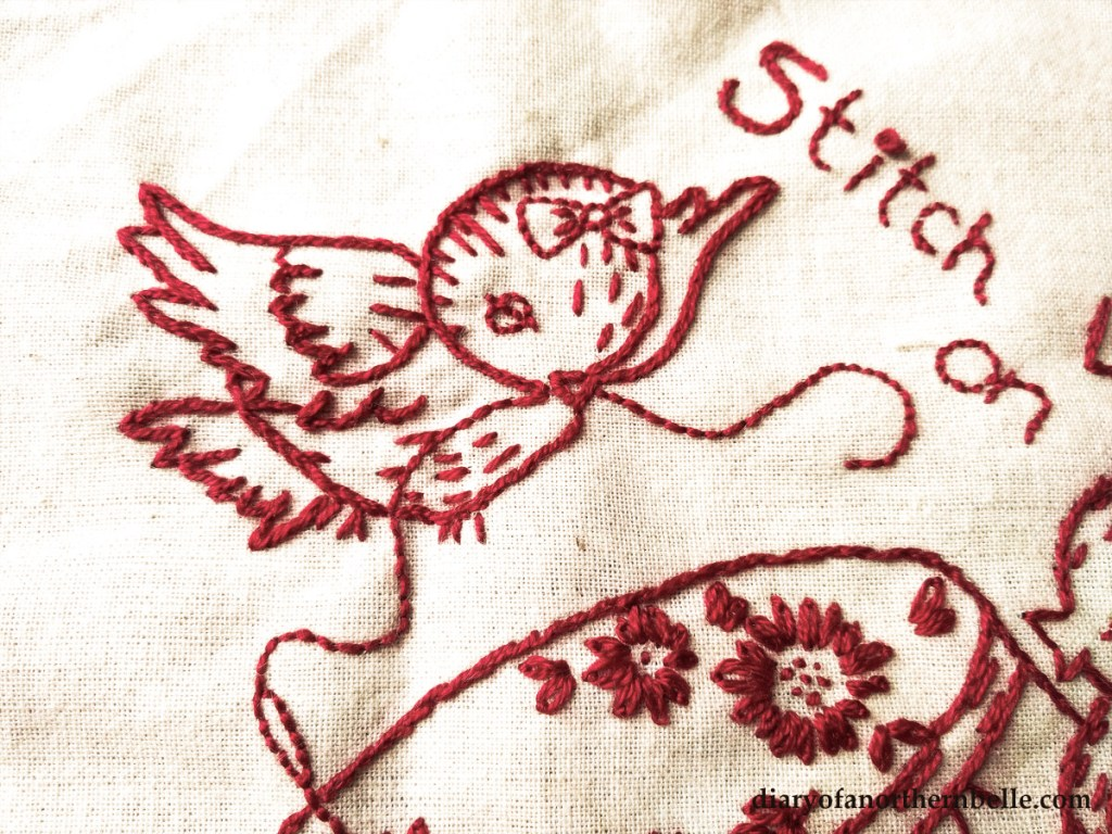 redwork embroidery vintage bird holding a piece of thread in its beak