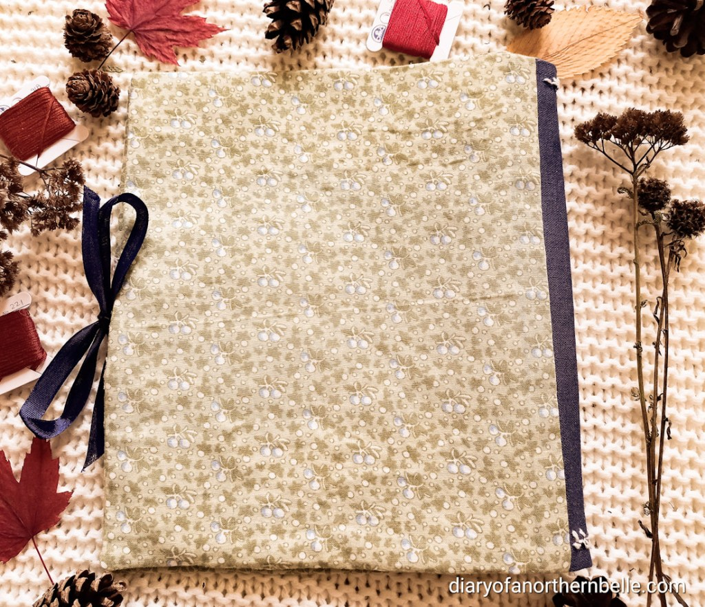 flat lay view of closed stitch book showing the back cover