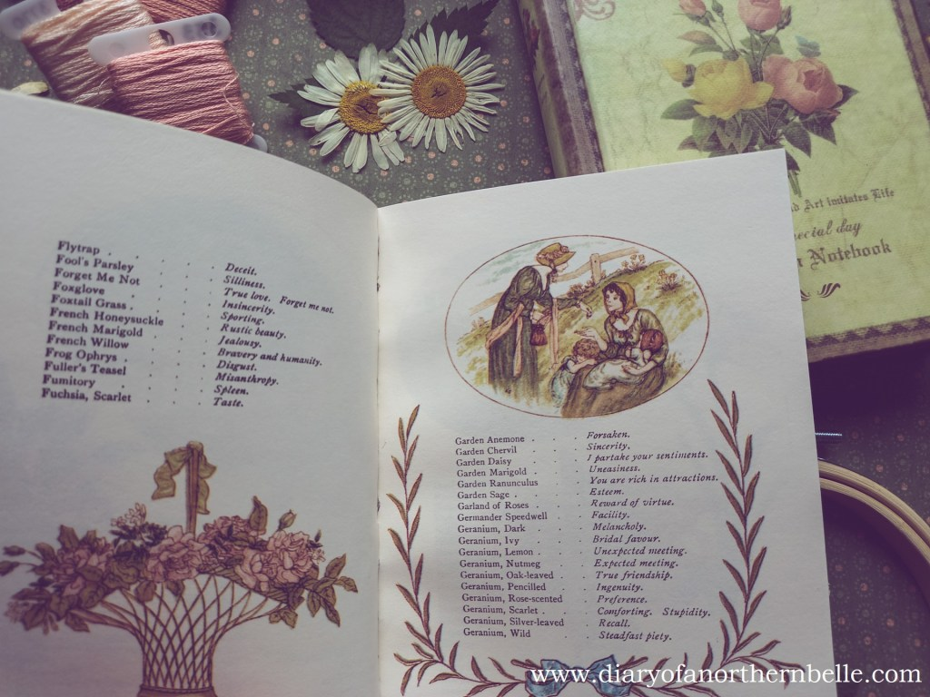opened floriography dictionary showing list of flowers and their meaning