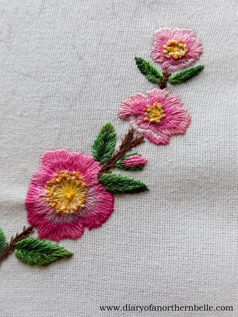 completed branch of embroidered wild roses