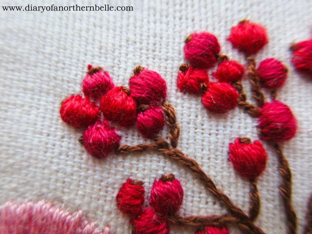 """embroidered currant berries with little """"end"""" in brown floss"""