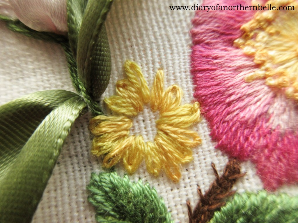 lazy-daizy stitches of varying sizes stitched all around the daisy, creating the petals