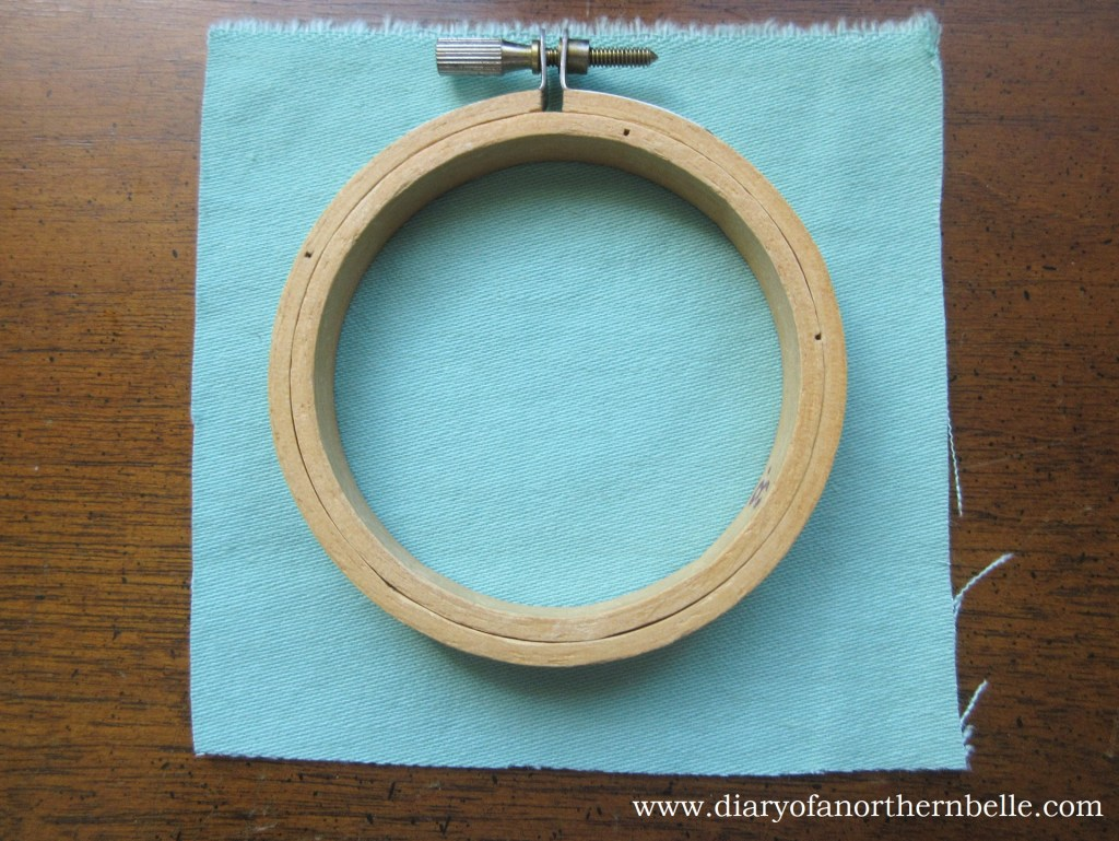 fabric cut to fit inside small embroidery hoop