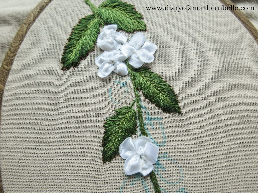 blackberry flowers made with white ribbon pieces gathered together