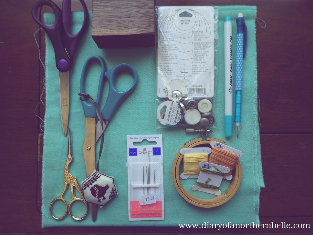 materials for making the embroidered buttons; button kit, fabric, paper scissors, fabric shears, snips, embroidery hoop, embroidery floss, needles, marking tools, wood block