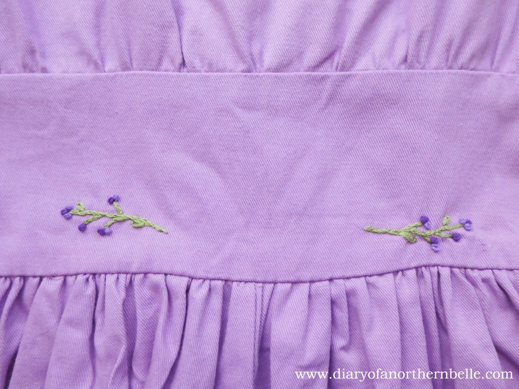 view of embroidered bodice on lilac dress back