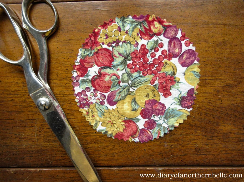 circle of decorative fabric cut with pinking shears