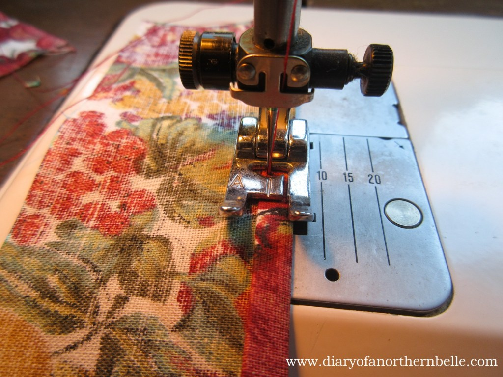 ruffle hem being sewn down at the sewing machine