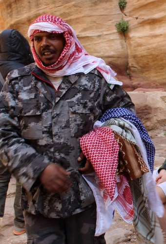 This Bedouin peddles traditional Jordanian scarves to tourists.