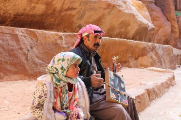 A Bedouin plays the rebab, authentic bowed instrument, for tourists in Petra.