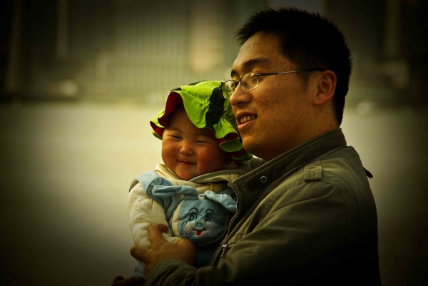 Chinese father holding his child.
