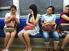 Young Chinese women riding the Chongqing subway.