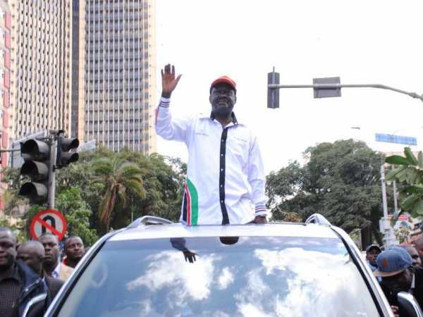 CORD leader Raila Odinga waves to supporters during their anti-IEBC demos. photo/PATRICK VIDIJA
