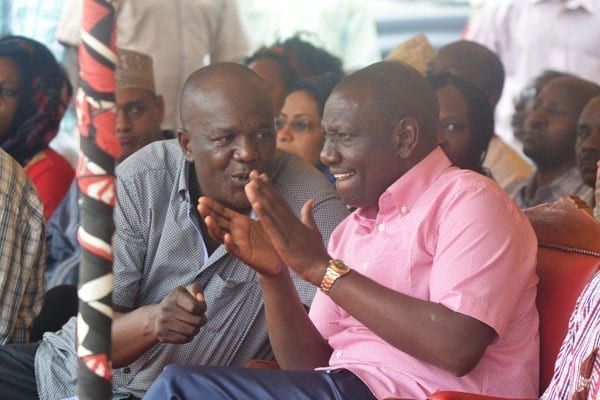 Deputy President William Ruto (right) chats with Kilifi North MP Gideon Mung'aro at Dr Kraph GroundS in Rabai for a funds drive for women's group. PHOTO | KAZUNGU SAMUEL | NATION MEDIA GROUP