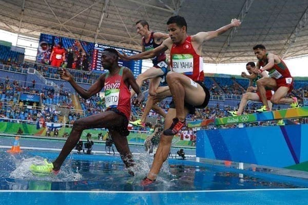 From left: Kenya's Conseslus Kipruto, France's Yoann Kowal, Tunisia's Amor Ben Yahia compete in the Men's 3000m Steeplechase Round 1 during the athletics competition at the Rio 2016 Olympic Games at the Olympic Stadium in Rio de Janeiro on August 15, 2016. PHOTO | AFP