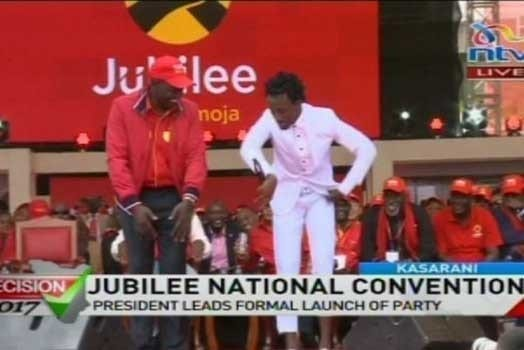 Bahati does a jig with Deputy President William Ruto. PHOTO   NTV
