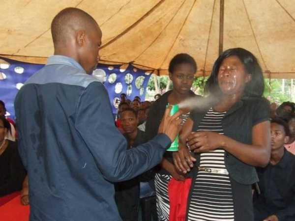 Prophet Lethebo Rabalago sprays Doom on a congregant at Mount Zion General Assembly (MZGA) account./Courtesy