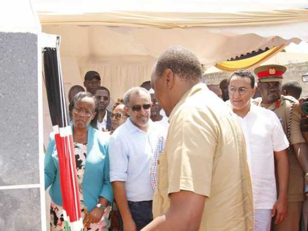 Suleiman Shahbal [in spectacles] looks on as President Uhuru Kenyatta commissions the Storm Water Drainage at Bamburi in Mombasa on Thursday, December 6. /BRIAN OTIENO