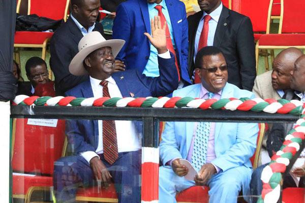 Opposition leader Raila Odinga seats next to National Police Service Commission chairman Johnston Kavuludi during Madaraka Day celebrations at Kabiruini grounds in Nyeri county on June 1, 2017. PHOTO | JOSEPH KANYI | NATION MEDIA GROUP