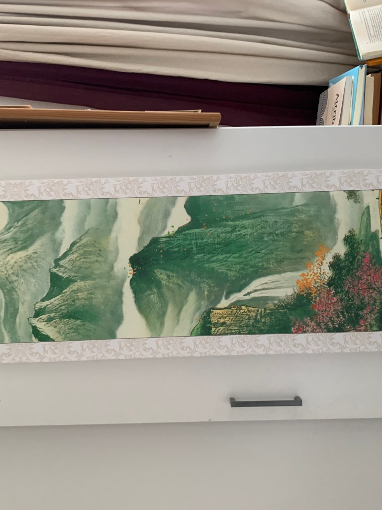 cheap chinese scroll showing mountains and waters and mists, hanging on my wardrobe