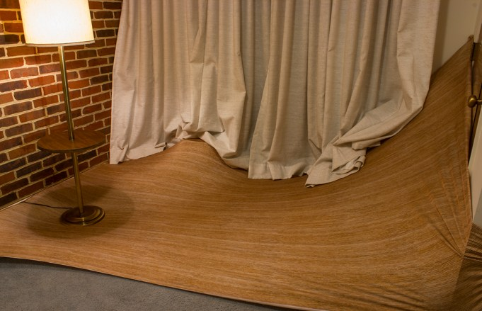 installation with wood grain fabric