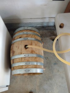 Whiskey barrel filled with beer.