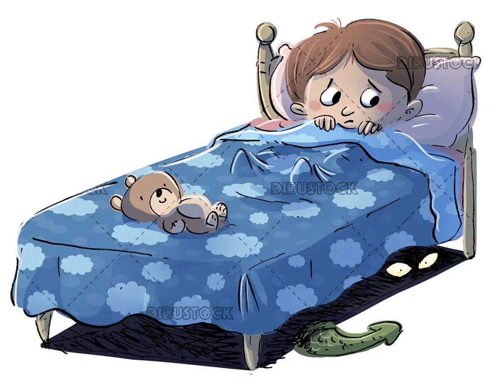 boy in bed at night afraid of monsters isolated