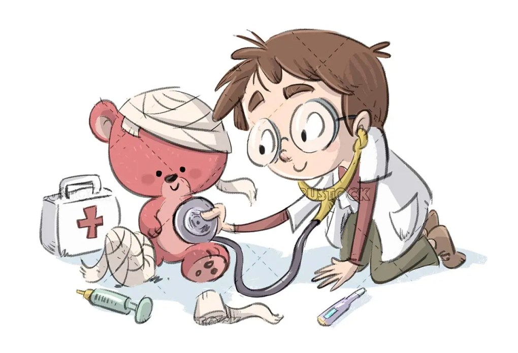 boy playing being a doctor with teddy bear