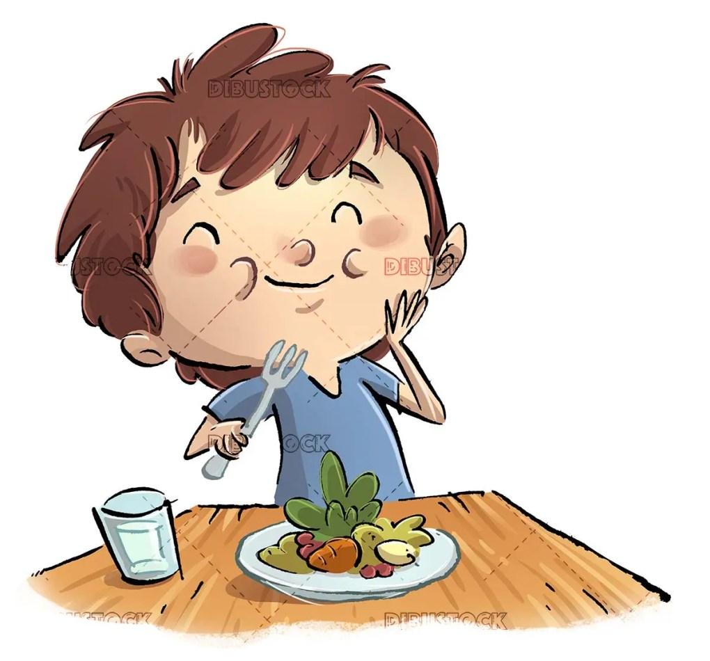 boy sitting at the table eating a plate of salad