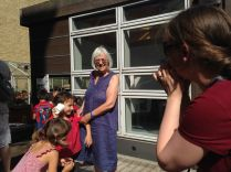 A grandma watches science in action at Science Corner