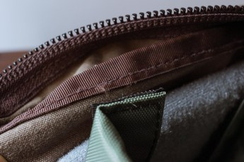 The internal seams of the bag can get caught in the divider's velcro.