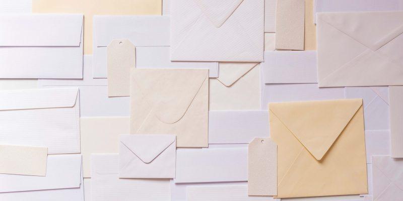 paper envelope paper lot background background image scaled