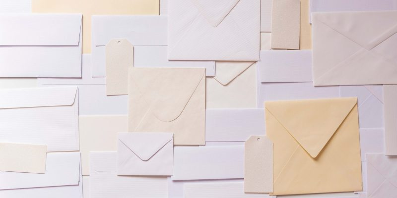 paper envelope paper lot background background image scaled