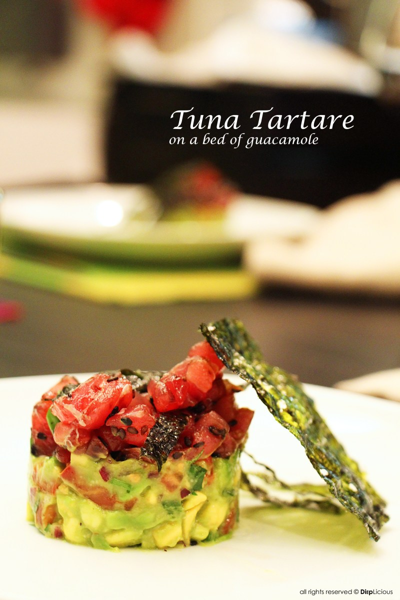 TUNA TARTARE ON A BED OF GUACAMOLE
