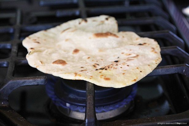 baking roti over the burner