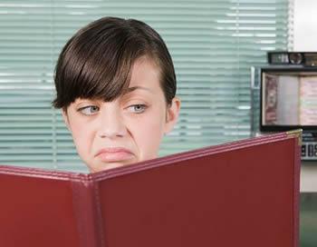 Girl frowning at menu.