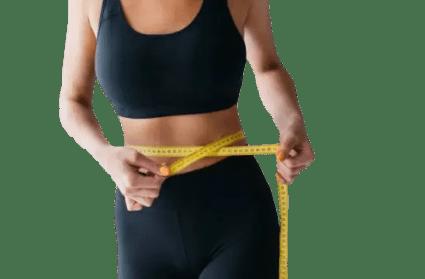 femme qui mesure sa taille sa perte de poids