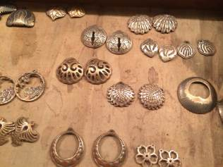These are the first finished jewelry parts--prototyped with 3D printing and recreated with metal clay. These were hammered in to domed form, which also work hardens them.