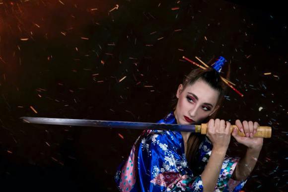 Japanese samurai girl holding a sward