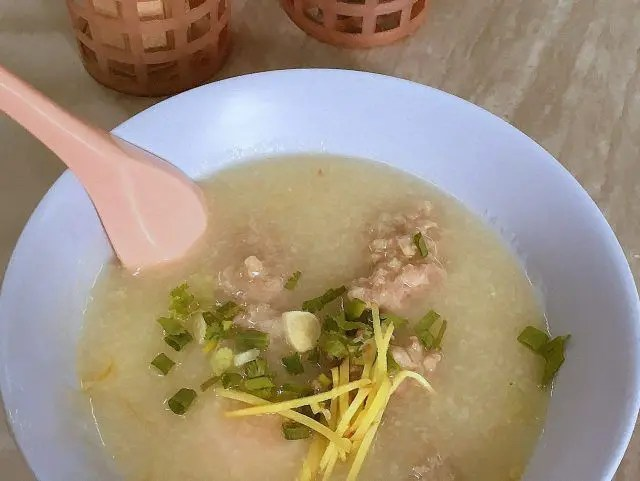 A bowl of porridge at Jok Prince makes a great Bangkok breakfast. Which is why it's one of my fave Bangkok cheap eats.