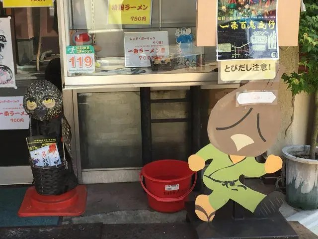 This black monster gaurds the doorway of one of the must stops in Kyoto's Monster Street - the home of Yokai 'monster' ramen.
