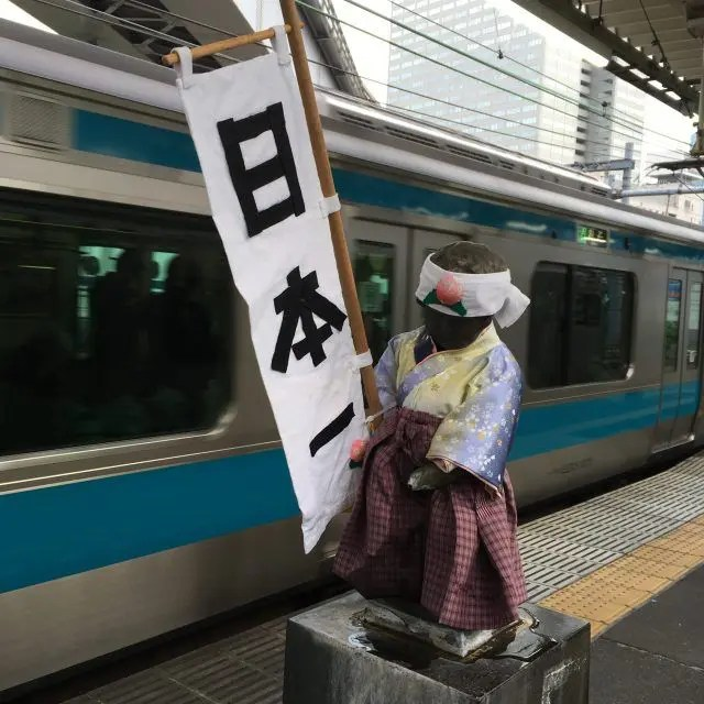 This statue at Tokyo's Hamamtsucho station has a heap of different outfits. Go visit him if you're looking for unusual things to do in Tokyo