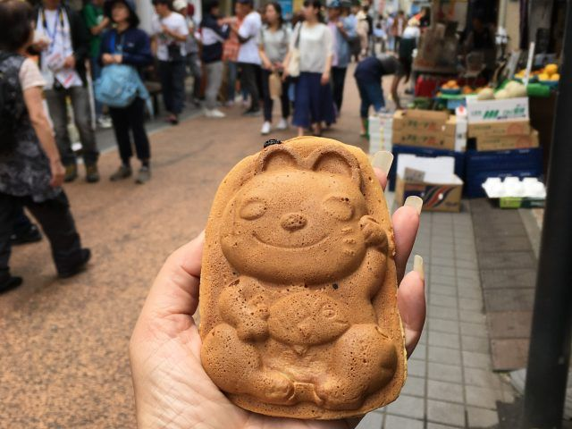 The main shopping street in Tokyo's Yanaka district has lots of shops for cat lovers, It's definitely one of the cute things to do in Tokyo,
