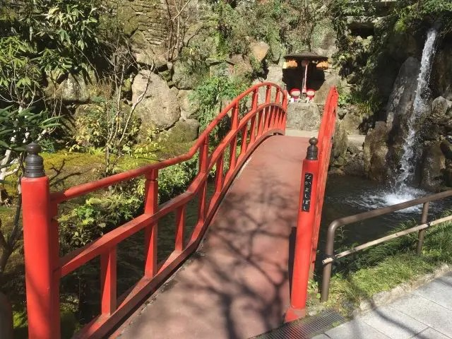 The Nanzoin Temple in Fukuoka, Japan is famous for its giant Buddha statue, but the grounds are full of cute touches like this red bridge and waterfall.