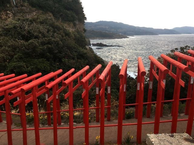 A side view of some of the 123 red torii gates of Motonosumi Inari Shrine in Western Japan