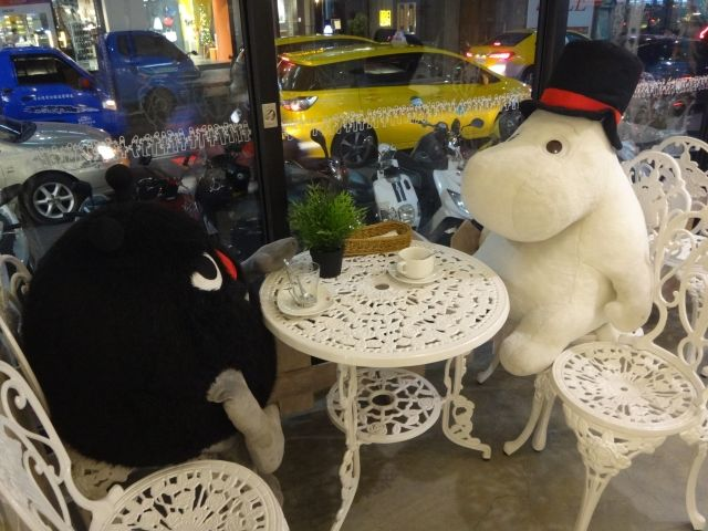 Two moomin toys sitting around a white table at the Moomin Themed Cafe in Taipei