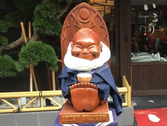 Billken statue outside a restaurant in Osaka