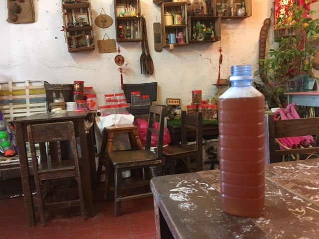bottle of nutmeg juice on a table in a cafe