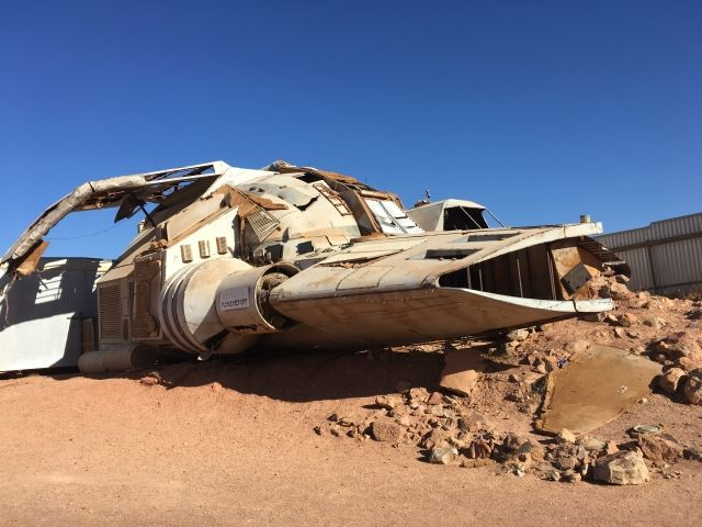 Large model spaceship surrounded by red rocks